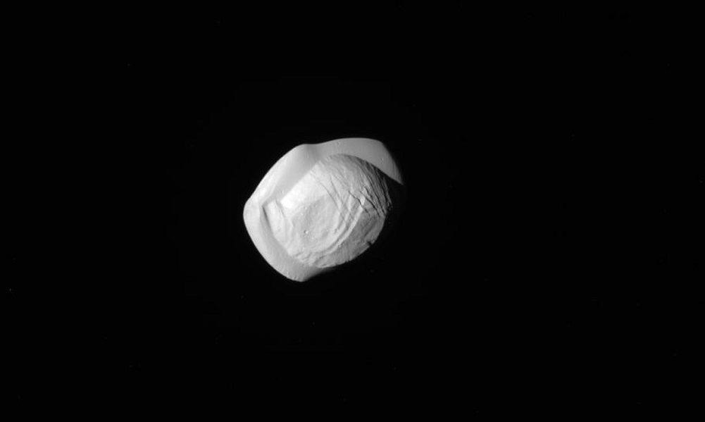 Cassini images show strange shape of Saturn's moon Pan